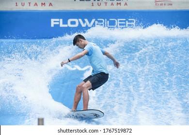 Kuala Lumpur,1 July 2020-Malaysia.A flow rider surfer enjoying surfing at an indoor surfing simulator near Kuala Lumpur.