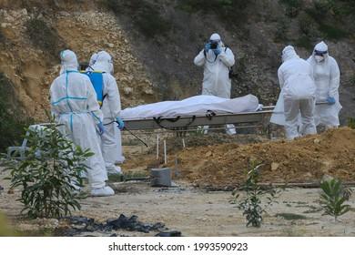 Kuala Lumpur,19 June 2021,Malaysia-Malaysia health workers wearing a full personal protective equipment while handling covid 19 funeral in Kuala Lumpur.