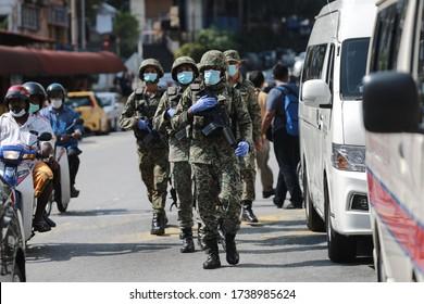 Kuala Lumpur,23 May 2020-Malaysia. Malaysian military personnel is on guard at lock down area near Kuala Lumpur amid covid 19 pandemic.