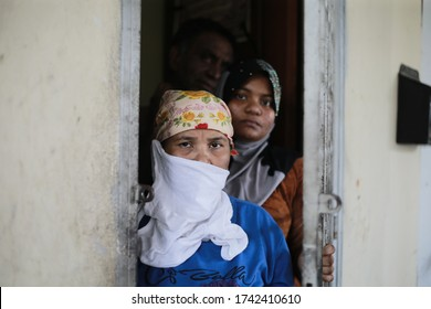 Kuala Lumpur,27 May 2020-Malaysia.A picture of a Rohingya muslim family while wearing a scarf and face mask to protect from covid-19 pandemic in Kuala Lumpur.