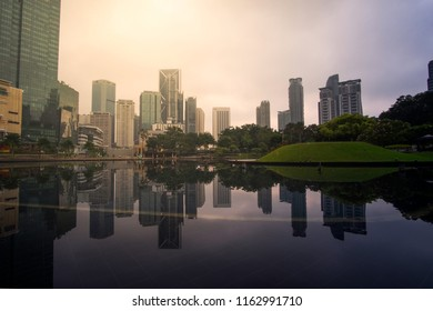 KUALA LUMPUR-29.7.2018 : Symphony Lake KLCC during Sunrise With Clear Reflection.Soft Focus due to Long Exposure.