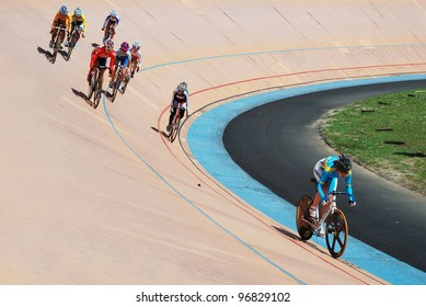 KUALA LUMPUR-FEB 11: A female rider from Kazakhstan leads in the Keirin category during the Asian Cycling Championships 2012 at Kuala Lumpur Velodrome, Malaysia on February 11, 2012