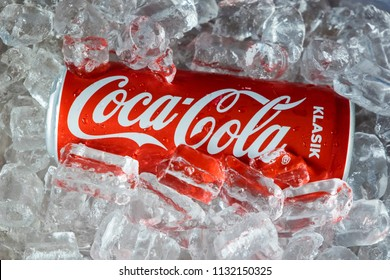 KUALA LUMPUR,MALAYSIA - 11.7.2018 : A Can of Coca Cola inside ice cube. Coca Cola is One Malaysian Favourite Drink.
