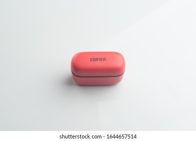 Kuala Lumpur,Malaysia, 14 February 2020, A  red Edifier bluetooth TWS 2, over white background.  Edifier is a Chinese audio manufacturer that produces speakers, music systems, and headphones,