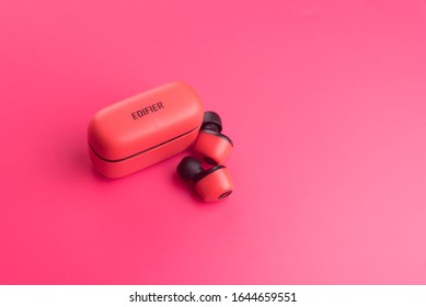 Kuala Lumpur,Malaysia, 14 February 2020, A  red Edifier bluetooth TWS 2, over red background.  Edifier is a Chinese audio manufacturer that produces speakers, music systems, and headphones,