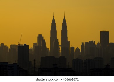 KUALA LUMPUR,MALAYSIA - 14TH APRIL 2016; A cloudy sunset  in Kuala Lumpur, the capital of Malaysia. Its modern skyline is dominated by the 451m tall KLCC, a pair of glass and steel clad skyscrapers.