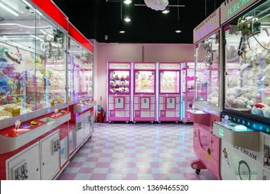Kuala Lumpur,Malaysia - April 13,2019 : Colorful arcade game toy claw crane machine where people can win toys and other prizes which is located in the shopping mall,Kuala Lumpur.