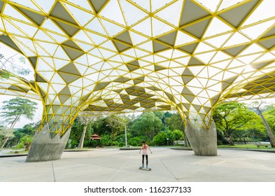 Kuala Lumpur,Malaysia -Aug 22,2018 : Lake Gardens also known as Kuala Lumpur Perdana Botanical Gardens, it is KL's first large-scale recreational park. A  person can seen playing skate board around it