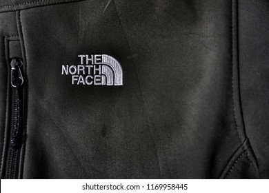 Kuala Lumpur,Malaysia - August 2018: Closeup The North Face logo symbol icon emblem on black jacket for sale in shop.The North Face is an American outdoor product company specializing in outerwear.