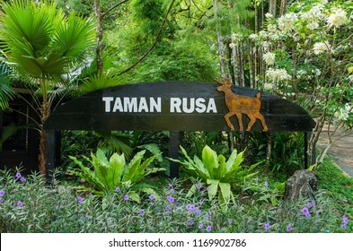 Kuala Lumpur,Malaysia – August 31,2018 : Deer Park signage with beautiful flora decoration which is located at the entrance of the Deer Park in the Kuala Lumpur Perdana Botanical Gardens,Malaysia.