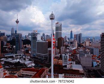 Kuala Lumpur,Malaysia - December 28, 2017: Aerial view of Malaysia's flag over Kuala Lumpur's skyscrapers