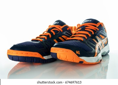 KUALA LUMPUR,MALAYSIA - JULY 10,2017 : A pair of Asics Gel-Rocket shoes against white background on reflective surface.Asics is a Japanese multinational corporation athletic equipment company.