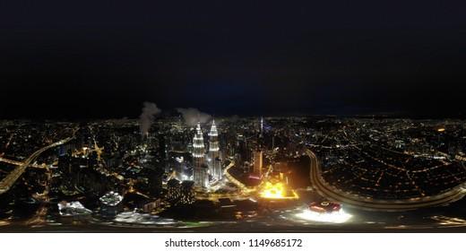 KUALA LUMPUR,MALAYSIA - JUN 7 2018, Beautiful 360 Panorama night view in a metropolitan Kuala Lumpur- drone shot 360 degrees.