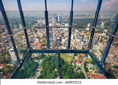 KUALA LUMPUR/MALAYSIA - MARCH 13, 2017: City view through transparent glass of Sky box in Menara KL tower, Kuala Lumpur