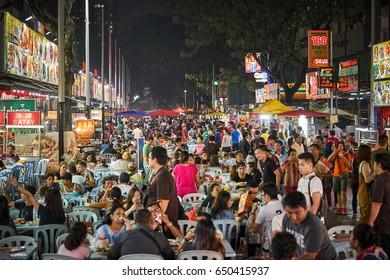 KUALA LUMPUR/MALAYSIA - MARCH 4, 2017: Jalan Alor food street full of people during night in Kuala Lumpur