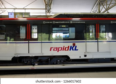 KUALA LUMPUR,MALAYSIA - MARCH 4TH,2018 : LRT train at one of the station.LRT or light rapid transit is a fully automated and driverless rail system.