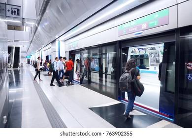 Kuala Lumpur,Malaysia - November 25, 2017 :  Commuter traveling the train in the MRT station. MRT (Mass Rapid Transit) is the latest public transportation system in Malaysia.