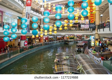 Kuala Lumpur,Malaysia - September 11,2018 : The Mines Cruise is a boat ride on two large lakes next to The Mines shopping mall in Seri Kembangan,people can seen exploring around it.