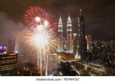 Kuala Lumpur/Malaysia-01012018: Top view of Kuala Lumpur with Petronas Twin Towers at night with fireworks during new year celebration, Malaysia.