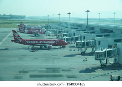 Kuala Lumpur/Malaysia-02 25 2019: Line of Airasia Airplanes in Kuala Lumpur International Airport Terminal 2