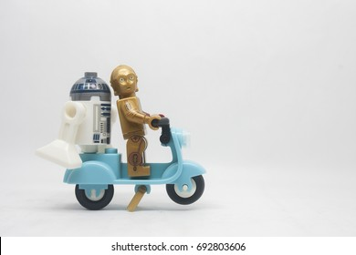 KUALA LUMPUR,MALAYSIA-AUGUST 7 2017:close up of Lego star wars C3PO and R2D2  on scooter isolated on white background.