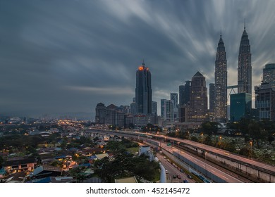 KUALA LUMPUR,MALAYSIA-DECEMBER 17 2015:The petronas twin tower and its surrounding buildings views from an apartment. The image may contain noise and soft effect due to long exposure