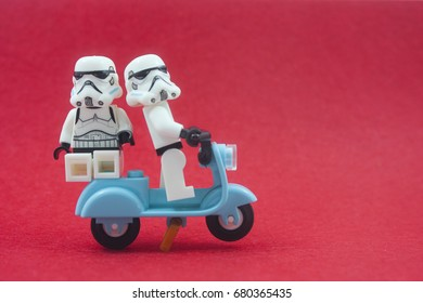 kuala lumpur,malaysia-july 18 2017;close up of lego star wars storm troopers on scooter over red background