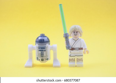 kuala lumpur,malaysia-july 18 2017;close up of lego star wars robot R2D2 and Luke Skywalker over yellow background.