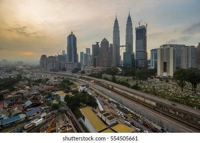 KUALA LUMPUR,MALAYSIA-JUNE 2 2016:The Petronas twin tower and its surrounding buildings views from kampung baru