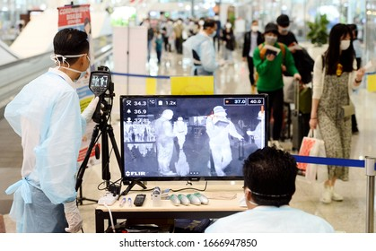 Kuala Lumpur/Malaysia-March 05,2020. Malaysian health Ministry officers use a thermal scanner to check the temperatures of passengers arriving at the Kuala Lumpur International Airport.