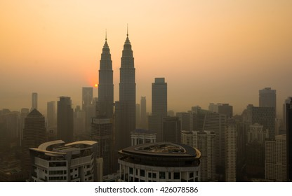 KUALA LUMPUR,MALAYSIA-MARCH 17 2016:Petronas Twin Tower views during hazy sunrise.  The image may look soft and blurry due to the haze