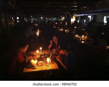 KUALA LUMPUR,MALAYSIA-MARCH 31:Unidentified Malaysian families experience Earth Hour 2012 while having satay dinner in K. Lumpur on Mar 31 2012.The event is held annually on the last Saturday of March