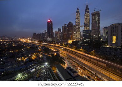 KUALA LUMPUR,MALAYSIA-MAY 3 2016:The Petronas Twin Tower and its surrounding buildings views during hazy sunrise