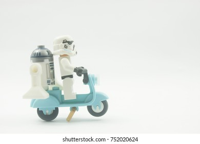 KUALA LUMPUR,MALAYSIA-OCTOBER  9TH 2017;close up of Lego star wars storm trooper and R2D2 on scooter over white background.Lego Mini figures are manufactured by The Lego Group.