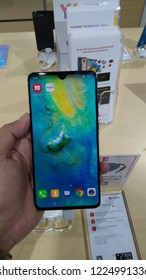 KUALA LUMPUR-November 9, 2018: Hand hold Huawei mate 20 smartphone at an Huawei store in Plaza Low Yat. Huawei is a brand of the worlds largest telecommunications equipment manufacturer Huawei (China)