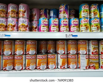 KUALA LUMPUT, MALAYSIA - JUNE 26, 2017 : Cans of condensed milk on a self in a supermarket.