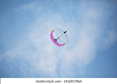 "Kuala Terengganu, Terengganu - 4 June 2019. kite moon or known as ""wau bulan"" flying high with simple colour scheme . editorial - Image"