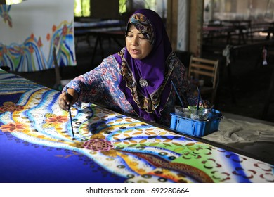 Kuala Terengganu, Terengganu, Malaysia - April 23 2016, Malay woman use brightly colored cotton prints with splashy, large designs; some also wear tie-dyed, wood-block, or batik prints.