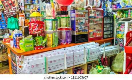 """KUALA TERENGGANU, Malaysia - MAY 31st 2018 : Various food and drink products stocked on shelves in a local convenience store. """"Minuman Sejuk"""" is Cold Drinks, """"Barangan Runcit"""" is grocery items."""