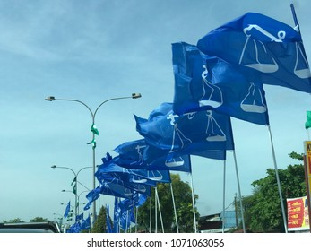 KUALA TERENGGANU, MALAYSIA-APRIL 17, 2018 : Flags of Barisan Nasional political party hang on poles and ropes in preparation for 14th Malaysia Election which will be held in May 2018.