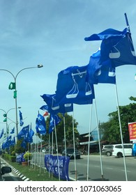 KUALA TERENGGANU, MALAYSIA-APRIL 17, 2018 : Flags and banners of Barisan Nasional political party hang on poles and ropes in preparation for 14th Malaysia Election which will be held in May 2018.
