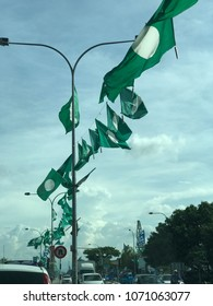 KUALA TERENGGANU, MALAYSIA-APRIL 17, 2018 : Flags and banners of Parti Islam Se-Malaysia hang on poles and ropes in preparation for 14th Malaysia General Election which will be held in May 2018.