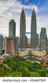 """KUALA-LUMPUR - NOVEMBER 28: """"Petronas Twin towers"""" on November 28, 2015 in Kuala Lumpur, Malaysia. """"Petronas towers"""" were tallest in the world from 1998 to 2004 and remain the tallest twin towers."""