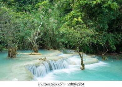 Kuang Si Waterfall in Luang Prabang, Laos. An idyllic waterfall with turquoise water and jungle surroundings