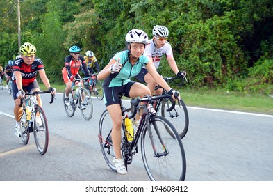 KUANTAN - FEBRUARY 6: unidentified cyclists in action during Kuantan160 on February 6, 2013 in Kuantan, Pahang, Malaysia. KUANTAN160 is a non-profit, non-race 160KM bicycle ride around Kuantan City.