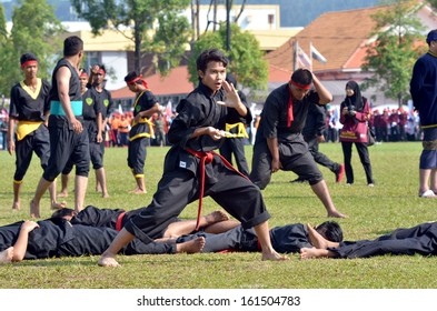 KUANTAN, MALAYSIA - AUG 31: Unidentified martial artist of silat, Malay traditional discipline at National Day parade, 55th anniversary of independence on August 31, 2012 in Kuantan, Pahang, Malaysia.