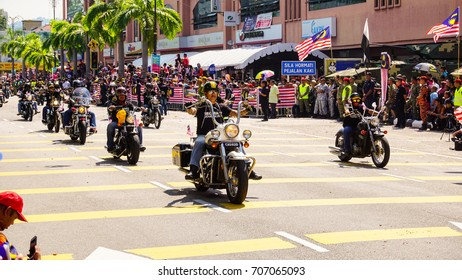 Kuantan, Malaysia - August 2017 -   people  watching a convoy of motorcycles during Malaysia national independence day.