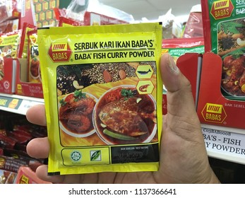KUANTAN, MALAYSIA- JULY 18, 2018 : Hand Holding, BABA'S fish curry powder. BABA'S range of products are made of the finest quality ingredients from around the world
