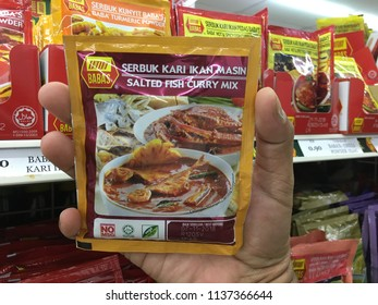 KUANTAN, MALAYSIA- JULY 18, 2018 : Hand Holding, BABA'S salted fish curry mix. BABA'S range of products are made of the finest quality ingredients from around the world