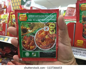 KUANTAN, MALAYSIA- JULY 18, 2018 : Hand Holding, BABA'S hot & spicy meat curry powder. BABA'S range of products are made of the finest quality ingredients from around the world